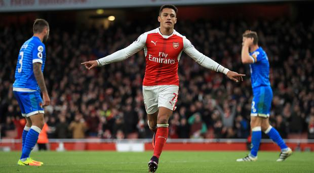Alexis Sanchez scored twice to help Arsenal to victory over Bournemouth