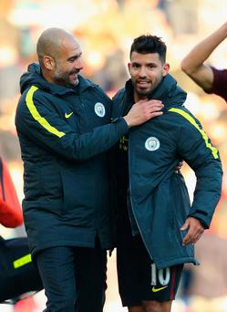 Pep Guardiola and Sergio Aguero. Photo: Getty