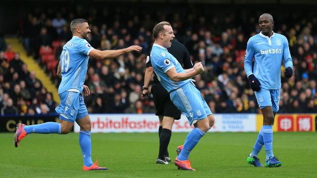 Stoke's Charlie Adam, centre, celebrates the goal. Photo: PA
