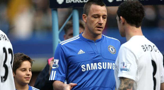 Chelsea's John Terry tries to shake hands with Manchester City's Wayne Bridge prior to kick-off in February 2010