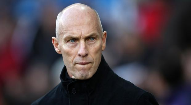 Swansea manager Bob Bradley knows Harry Kane will put his under-fire defence to the test at Tottenham