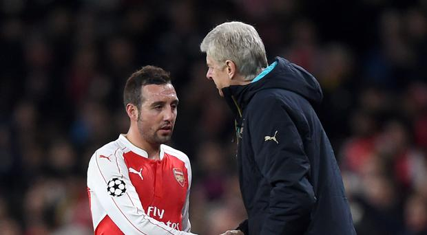 Arsene Wenger, pictured right, and Santi Cazorla