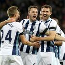 Jonny Evans (centre) celebrates after scoring West Brom's opening goal