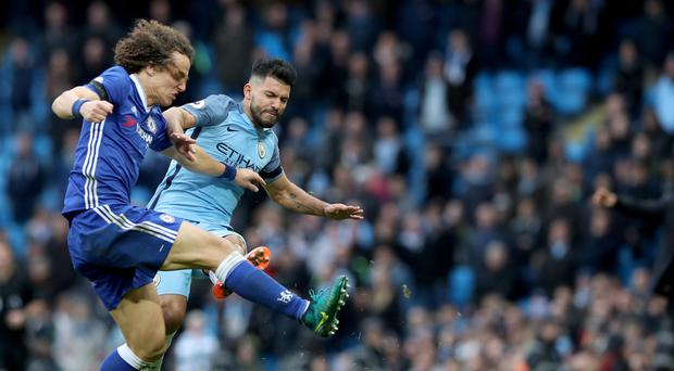 Manchester City's Sergio Aguero (right) was sent off for a bad tackle on Chelsea defender David Luiz