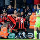 Steve Cook, second left, scored Bournemouth's equaliser against Liverpool