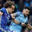 Sergio Aguero, right, has received a four-match ban following his dismissal for a reckless tackle on David Luiz, left