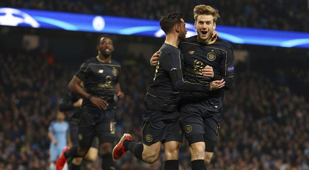 Patrick Roberts, pictured centre, scored for Celtic at the Etihad