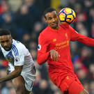 Joel Matip, right, missed Liverpool's defeat by Bournemouth with an ankle injury