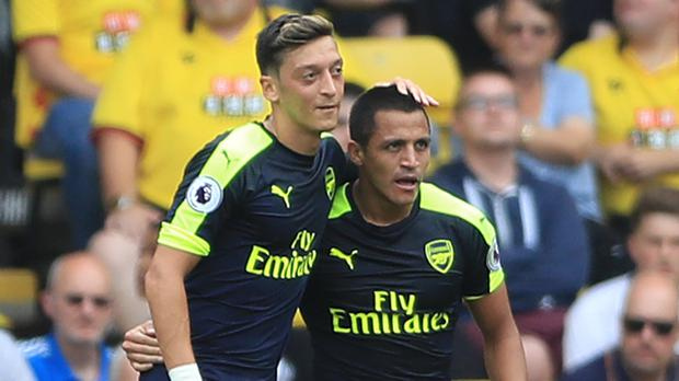 Alexis Sanchez, right, and team-mate Mesut Ozil have 18 months remaining on their Arsenal contracts