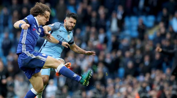 David Luiz, left, is in a race to be fit for Chelsea following this tackle from Sergio Aguero last weekend