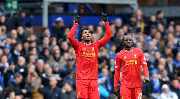 Liverpool's Daniel Sturridge, pictured left, celebrates his late equaliser at Goodison Park