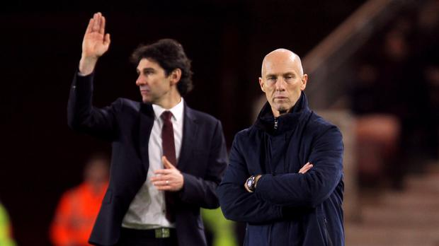 Swansea manager Bob Bradley (right) watches his side lose with Middlesbrough manager Aitor Karanka in the background