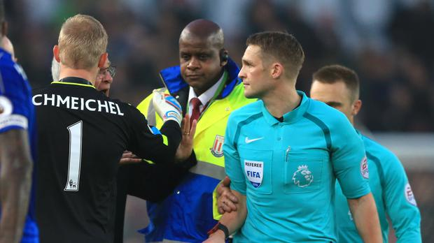 Kasper Schmeichel, left, tried to prevent Claudio Ranieri from remonstrating with Craig Pawson