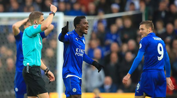 Leicester striker Jamie Vardy (right) is shown a red card by referee Craig Pawson