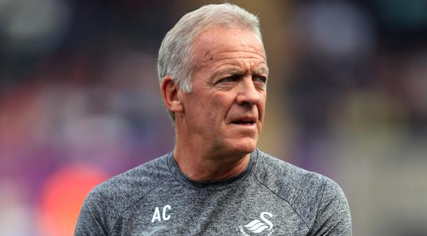 Caretaker boss Alan Curtis wants to see a return to Swansea's traditional playing style
