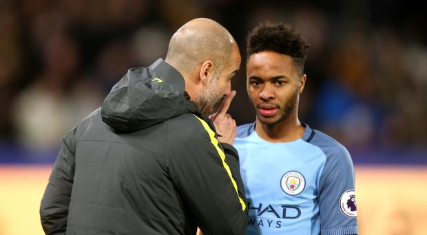 Pep Guardiola and Raheem Sterling