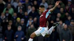 Andre Gray strokes home the first of his three goals