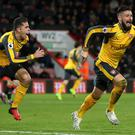 Olivier Giroud, right, has penned a new Arsenal deal
