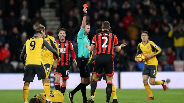 Simon Francis was shown a straight red after leaving Aaron Ramsey on the floor