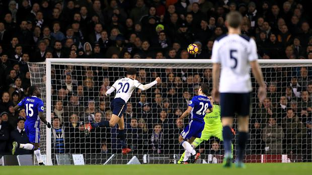 Tottenham midfielder Dele Alli heads home his first goal of the game against Chelsea