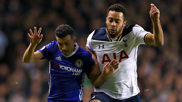 Mousa Dembele, right, battles with Chelsea forward Pedro