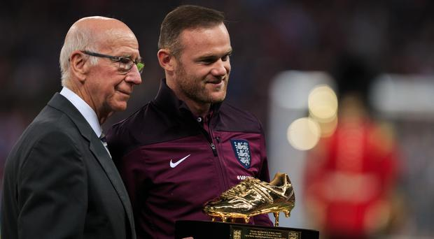 Wayne Rooney, right, equalled Sir Bobby Charlton's Manchester United goalscoring record on Saturday