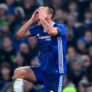 John Terry reacts after making his red-card tackle against Peterborough at Stamford Bridge Picture: Getty