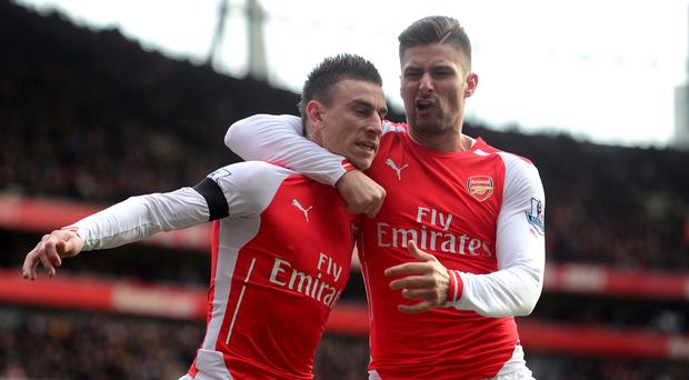 Arsenal duo Laurent Koscielny (left) and Olivier Giroud (right) have both signed contract extensions, along with midfielder Francis Coquelin