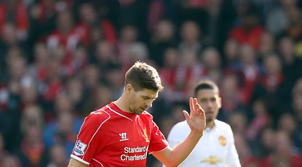 Liverpool's Steven Gerrard leaves the field after being sent off against Manchester United