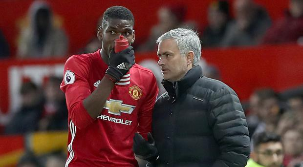 Paul Pogba, left, has been defended by manager Jose Mourinho