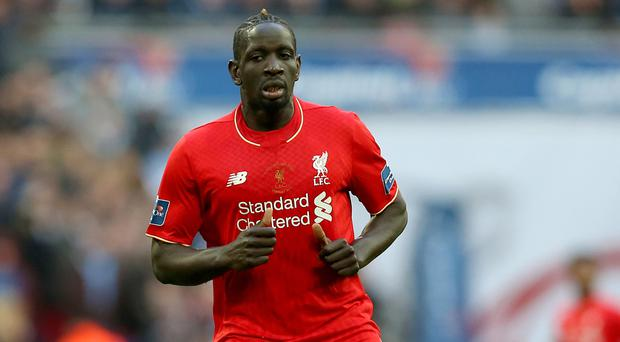 Banished Liverpool defender Mamadou Sakho has helped the club's youngsters in the under-23 squad