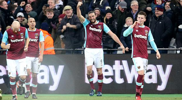 Andy Carroll, centre, celebrates his stunning goal