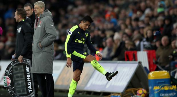 Arsenal's Alexis Sanchez shows his frustration at being substituted in the 4-0 win at Swansea