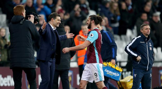 Andy Carroll, centre, got a hug from Slaven Bilic after his stunning goal in West Ham's win over Crystal Palace