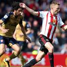 Sunderland midfielder Seb Larsson, right, has vowed to keep on fighting