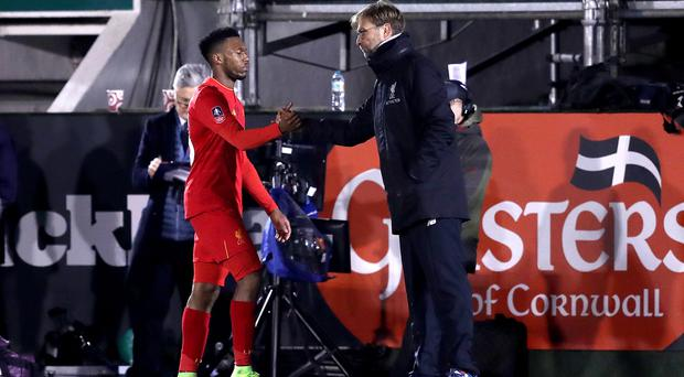 Liverpool's Daniel Sturridge, left, was substituted off by manager Jurgen Klopp at Plymouth
