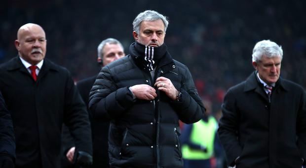 Despite Wayne Rooney's historic late goal, there was frustration for Jose Mourinho, centre
