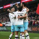 Andy Carroll (right) has saluted West Ham's team spirit