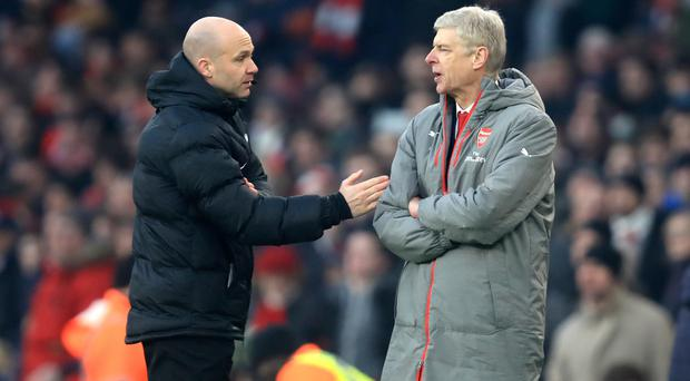 Arsene Wenger, right, clashed with Anthony Taylor