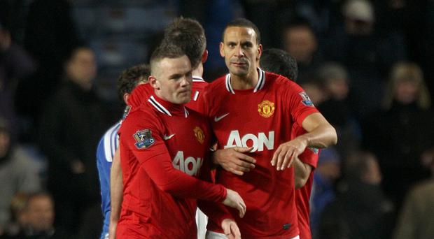 Wayne Rooney, left, and Rio Ferdinand were team-mates for 10 years