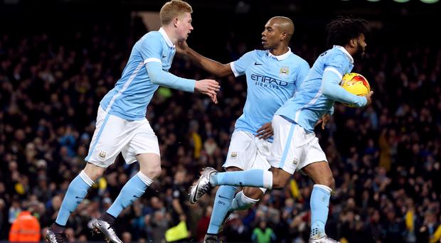 Manchester City's Kevin De Bruyne, left, is delighted to see Fernandinho, centre, return from suspension