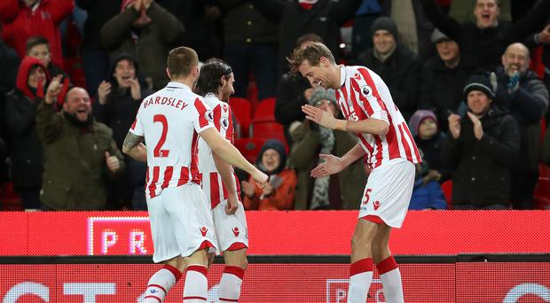 Stoke's Peter Crouch, celebrates scoring his 100th Premier League goal