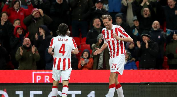 Peter Crouch (right) has become the 26th player to score 100 Premier League goals.