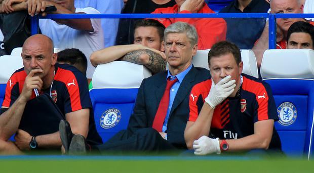 Arsene Wenger, centre, has witnessed some memorable matches at Stamford Bridge over the years