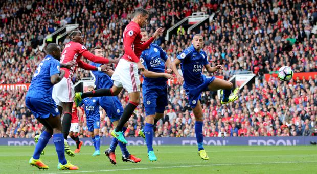 Chris Smalling, centre, opened the scoring when Manchester United faced Leicester earlier in the season