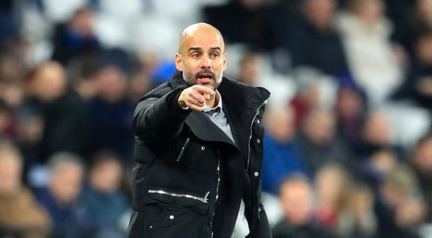 Manchester City manager Pep Guardiola is preparing to face Swansea