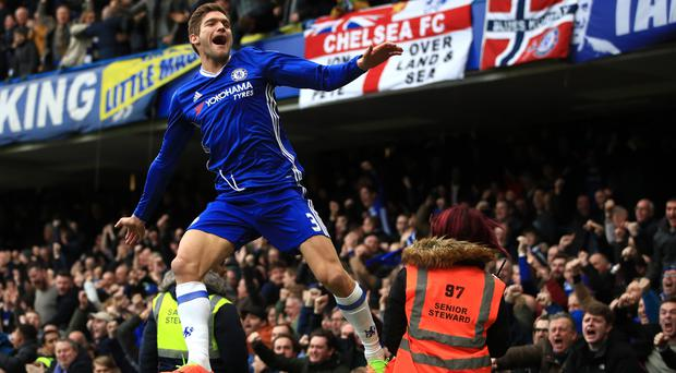 Chelsea's Marcos Alonso celebrates scoring his side's first goal against Arsenal