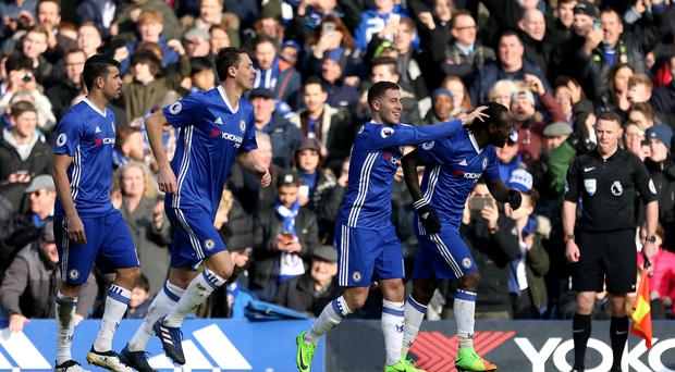 Chelsea's Eden Hazard, centre, celebrates scoring against Arsenal
