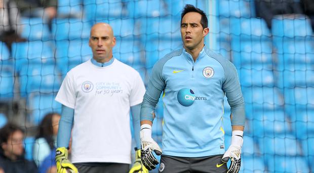 Willy Caballero (left) has backed fellow Manchester City goalkeeper Claudio Bravo to soon show his best