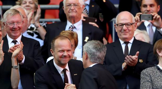 Ed Woodward, centre, has pledged to back Jose Mourinho in the summer